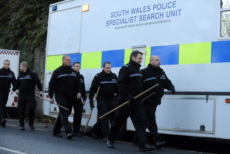 South Wales police specialist search units approach woodland in Aberkenfig